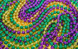 Leinwanddruck Bild - Colorful Mardi Gras beads background