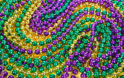 Colorful Mardi Gras beads background - 77591203
