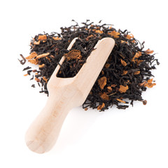 Black Dry Tea with a Wooden Spoon