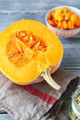 Half of raw pumpkin on napkin