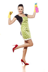 Happy young housewife posing on a white background