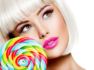 Closeup Face of a sexy girl with pink lips and multicolor sweet