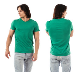 Young man posing with blank green shirt
