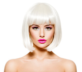 Face of a fashion model with bright pink make-up and bob hairsty