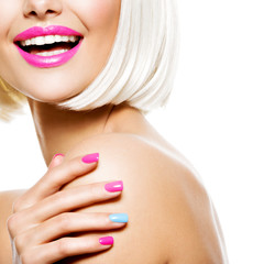 Part of a fun female face  with multicolor nails and white hairs