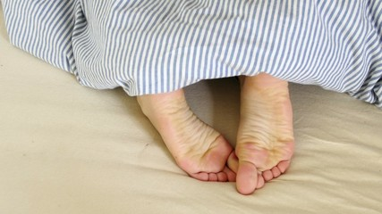 Female feet in bed