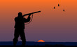 hunter with gun at sunset background - 77600056