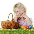 Cute child is happy to have her Easter eggs