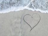 Fototapety Heart written in sand
