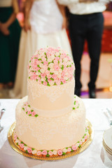 Wedding cake decorated with beautiful flowers.