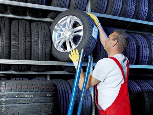 canvas print picture Car mechanic stores winter tires