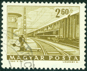 stamp printed in the Hungary shows passenger train
