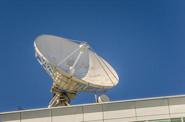 Big Satellite Dish against Blue Sky