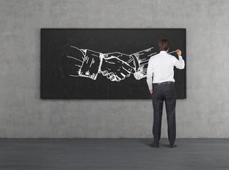 businessman drawing handshake