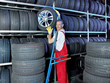 Car mechanic stores winter tires
