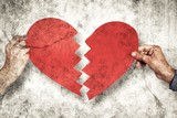 Composite image of two hands holding broken heart