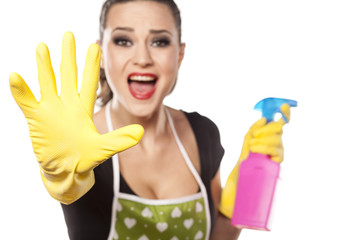 nervous housewife with rubber gloves showing stop gesture