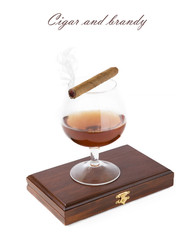 Cigar with smoke and brandy glass