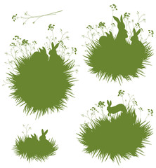 Vector silhouettes rabbits in grass.