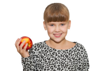 Portrait of cute girl holding an apple isolated