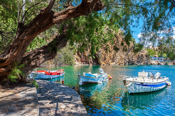 Boats on Lake Voulismeni. Agios Nikolaos, Crete, Greece