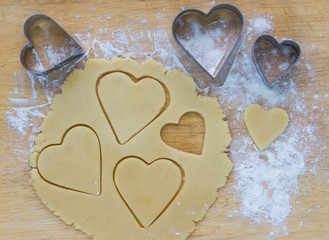 the dough and biscuits in the form of hearts