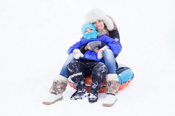 Young woman with child having fun on winter day