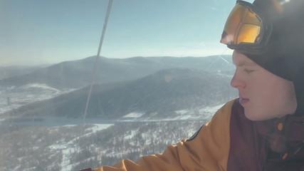 Snowboarder on the ski lift