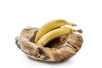 Wooden bowl with bananas