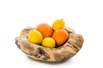 Wooden bowl with oranges and lemons