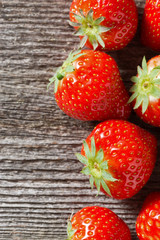 wooden background with fresh strawberries, vertical