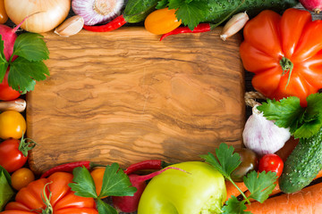 wooden board for recipe, spices and fresh vegetables, top view