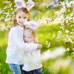 Two little sisters wearing bunny ears on Easter