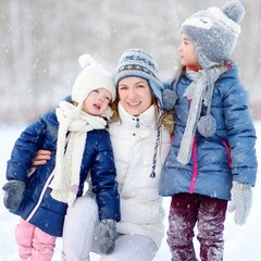 Happy family ot three having fun at winter