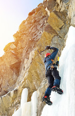 Ice climbing in winter mountains