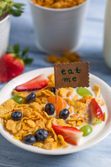 Enjoy your breakfast with cornflakes and fruits