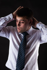 successful fashionable businessman isolated on black