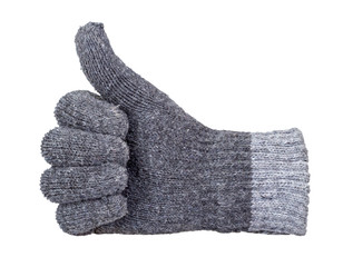 Thumb up showing by hand with grey knitting wool glove isolated