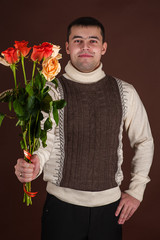 attractive man with a bouquet of roses