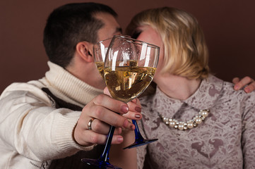 young couple kissing holding champagne glasses