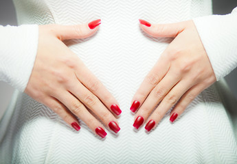 Woman showing her red nails, manicure