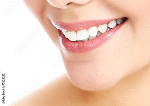 Leinwanddruck Bild Young smiling woman, white background, copyspace