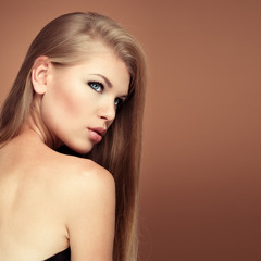 Hairstyle salon model. Glamour woman with perfect long hair