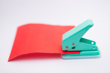 green paper punches with red paper