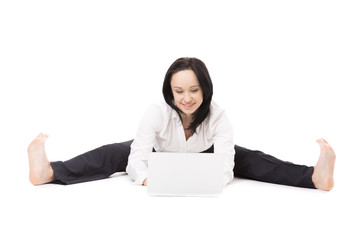 Young office woman sitting in splits with laptop on white backgr