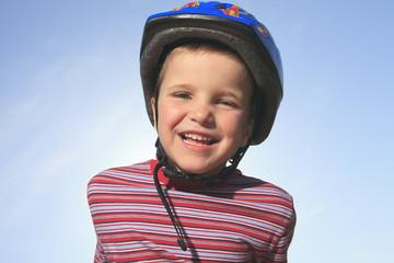 Boy having fun, rollerblading outdoor on a sunny summer day