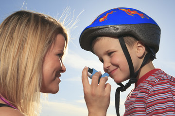 A boy having a asthma problem outside.