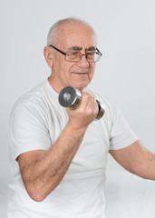 old sportsman with dumbbells