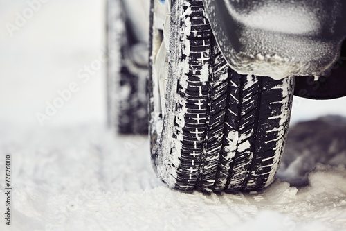 Detail of the tire on winter road - 77626080