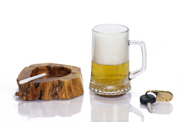 Beer, ashtray with cigarette